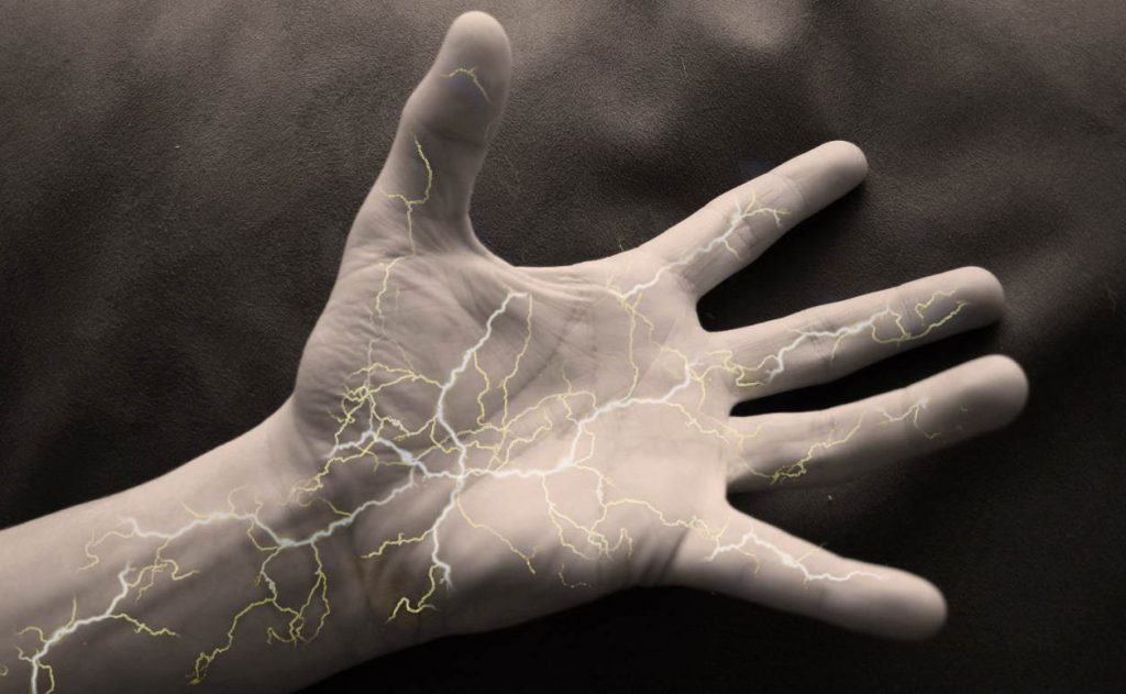 a hand with lightnings inside
